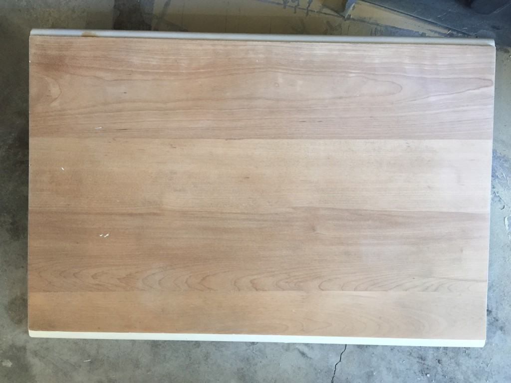Sanded finish and damage off drop leaf table top