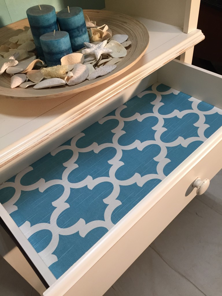 Beach style bookcase makeover with lined drawer for color pop