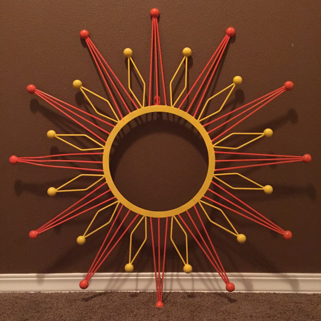Spray painted metal sun wall decor